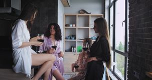 Pretty ladies feeling happy while celebrating bachelorette party at home in modern studio design drinks some wine and. Smiling large stock video