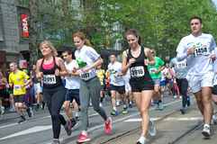 Pretty ladies run a marathon race Royalty Free Stock Photography