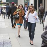 2 pretty ladies talking on phones. 2 very pretty ladies talk on the phone during rush hour in New York City on 5/17/17 Stock Photo