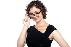 Pretty lady adjusting her eyeglasses Stock Photography