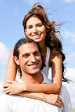 Pretty lady with arms around her man Royalty Free Stock Image