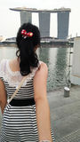Pretty Lady. Backview of a lady looking at the Marina Bay Sands Singapore Royalty Free Stock Images