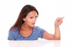 Pretty lady in blue t-shirt gesturing selecting Stock Photos