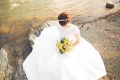 Pretty lady, bride in a wedding dress posing near river Royalty Free Stock Photo