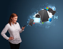 Pretty lady browsing on her smartphone. Pretty young lady browsing on her smartphone Royalty Free Stock Photo