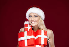 Pretty lady in Christmas cap Stock Image