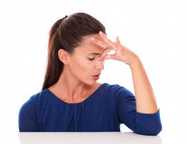Pretty lady with closed eyes suffering headache royalty free stock image