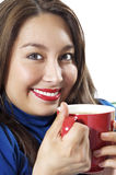 Pretty Lady drinking Coffee. Pretty Asian Hispanic Women enjoying her morning cup of coffee with a big smile on her face Stock Image