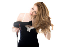 Pretty lady drying her hair with fen Royalty Free Stock Photos