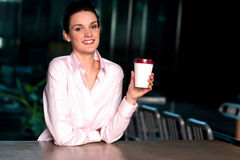 Pretty lady enjoying chilled liquid at refreshment Stock Images