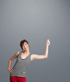 Pretty lady gesturing with copy space Stock Images