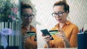 Pretty lady is happy while making an online purchase. Online banking, online payment concept.