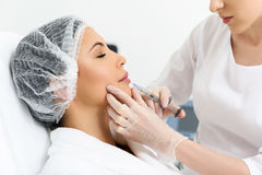 Pretty lady having hyaluronic treatment Stock Photo