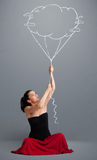 Pretty lady holding a cloud balloon drawing Stock Photo