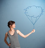 Pretty lady holding a cloud balloon drawing Stock Photos