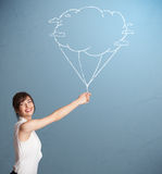 Pretty lady holding a cloud balloon drawing Royalty Free Stock Photo
