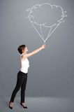 Pretty lady holding a cloud balloon drawing Stock Images