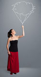 Pretty lady holding a cloud balloon drawing Royalty Free Stock Photography