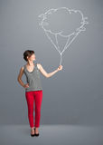 Pretty lady holding a cloud balloon drawing Royalty Free Stock Photos