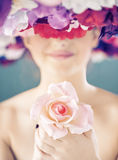 Pretty lady holding a pink rose Royalty Free Stock Photos