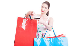 Pretty lady holding shopping bags and credit or debit card Royalty Free Stock Photos