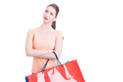 Pretty lady holding shopping bags smiling and being positive Stock Photo
