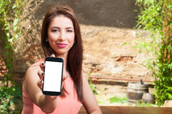 Pretty lady holding smartphone with blank screen Stock Photo