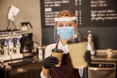 Free Pretty Lady In The Cafe Offering You Hot Beverage Stock Images - 201785094
