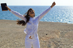 Pretty lady jumping with joy royalty free stock photography