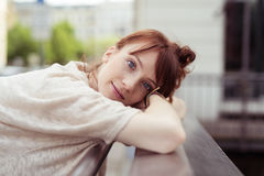 Pretty Lady Leaning on her Hands on the Railings Royalty Free Stock Image