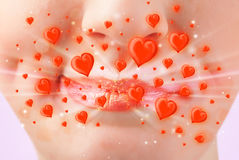 Pretty lady lips with lovely red hearts Stock Photos