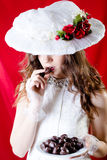 Pretty lady with long hair in retro hat and gown Royalty Free Stock Photos
