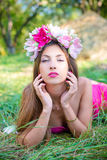 Pretty lady with long hair in wreath on grass Royalty Free Stock Images