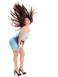 Pretty lady with long hairs flying upwards Stock Image
