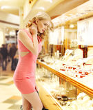 Pretty lady looking at the shop window Stock Photo