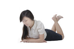 Pretty lady lying on floor Royalty Free Stock Images