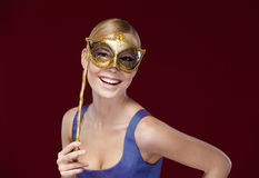 Pretty lady with masquerade masque Stock Photos