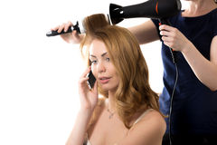 Pretty lady on phone in barber shop Stock Photos