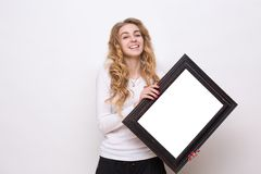 Pretty lady with picture Royalty Free Stock Photos