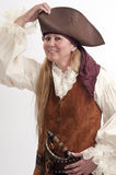 Pretty lady pirate adjusts her hat Stock Images