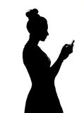 Pretty lady playing the cell phone Royalty Free Stock Image