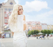Pretty lady playing the soap bubbles Royalty Free Stock Photos