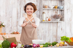 Pretty lady is preparing to cook salad Stock Photos