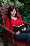 Pretty Lady Reading Book Stock Photo