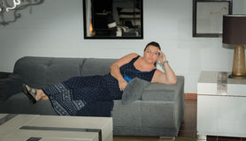 Pretty lady relaxing thinking on the couch inside the room Stock Photography