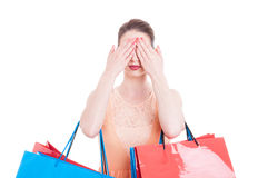 Pretty lady shopper covering her eyes with both hands Royalty Free Stock Images