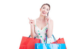 Pretty lady shopper having a call and feeling surprised Stock Photography