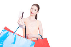 Pretty lady shopper showing credit card and smiling Stock Images
