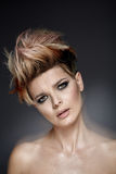 Pretty lady with a short colored haircut. Pretty woman with a short colored haircut Stock Photography