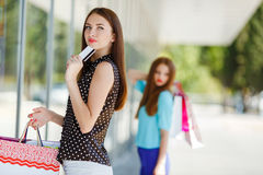 Pretty lady showing credit card in the mall Stock Photos